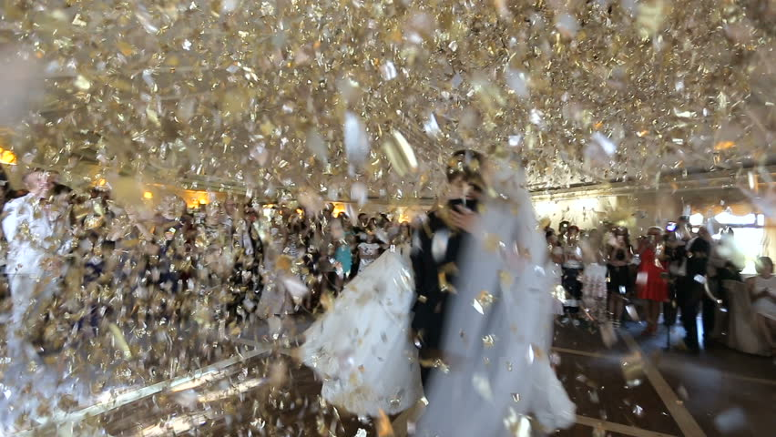 Beautiful brunette bride and handsome groom dancing first dance at the wedding party. Confetti in the air. Very tender moment Royalty-Free Stock Footage #31682623
