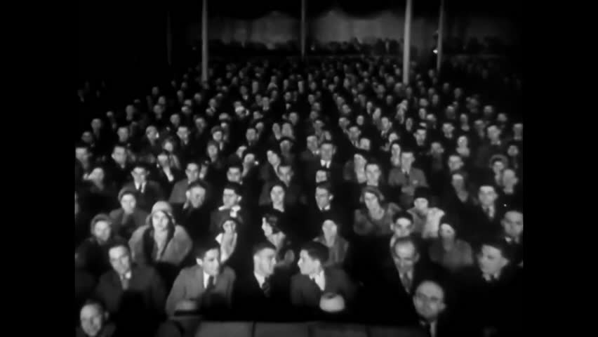 CIRCA 1940s - An audience sits in a movie theater and a human ear is shown, in 1926.
