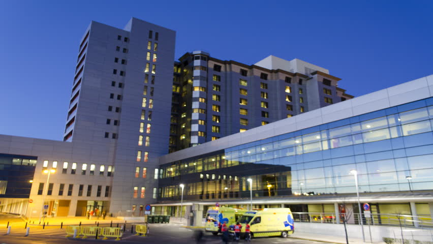 Generic Health Care Modern Hospital Exterior Building. Day to night Time Lapse