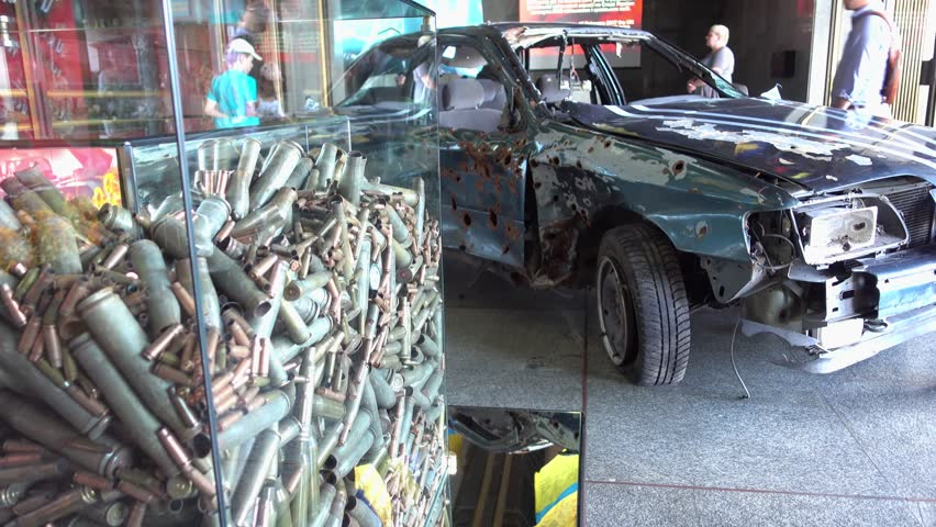 Kiev, Ukraine - 20th of June, 2017: 4K Eastern War exposition - Bullets and perforated car  | Shutterstock HD Video #31700173