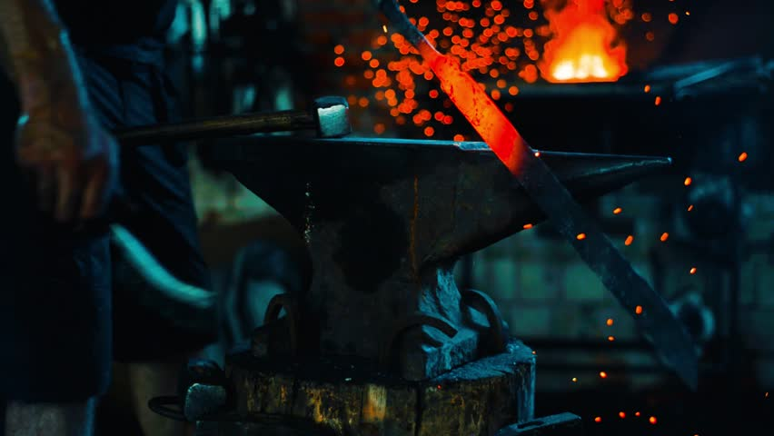 Blacksmith clean off dross from red-hot iron and forge sword blank on anvil