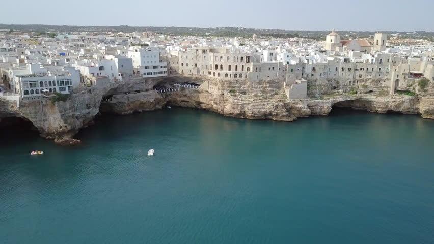 Polignano a Mare (Bari, Italy): heaven on earth. Coastal and caves aerial 4k drone footage video above sea