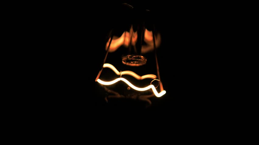 Close-up of a filament in the bulb (Blinking lamp, voltage fluctuations.)