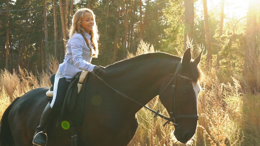 beautiful girl riding on a horse hugging her and stroking #31773361