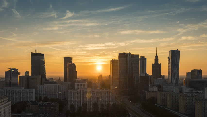 Sunrise over Warsaw downtown skyline with skyscrapers, Poland. Time lapse at dawn