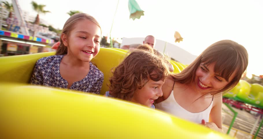 Multi-ethnic children on a funfair roller coaster ride with parents on summer holidays Royalty-Free Stock Footage #31788604