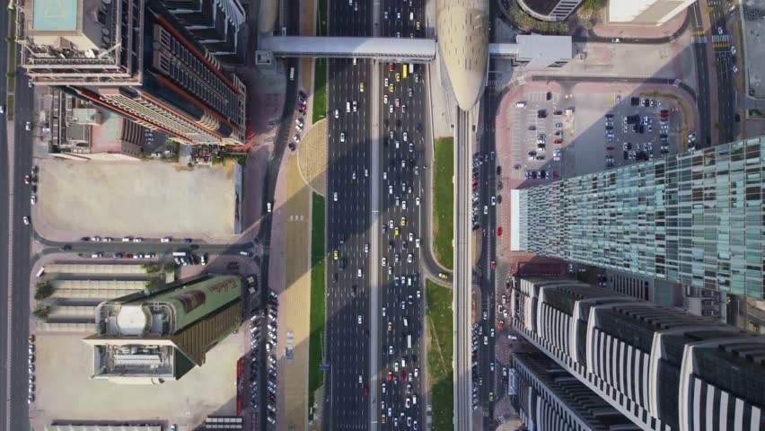 Excellent top aerial drone view on long busy highway road and modern skyscraper building in urban Dubai city panorama | Shutterstock HD Video #31789045