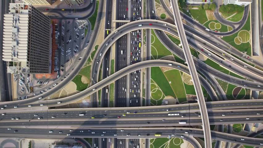 Long busy highway road and modern skyscraper building in urban Dubai city panorama in wonderful top aerial drone view | Shutterstock HD Video #31789114