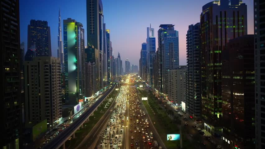 Huge futuristic skyscraper building of Dubai big city lights warm pink evening sunset in impressive aerial drone view | Shutterstock HD Video #31789150