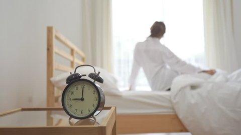 Closeup Alarm Clock, Young Asian Stock Footage Video (100% Royalty-free)  31297171 | Shutterstock