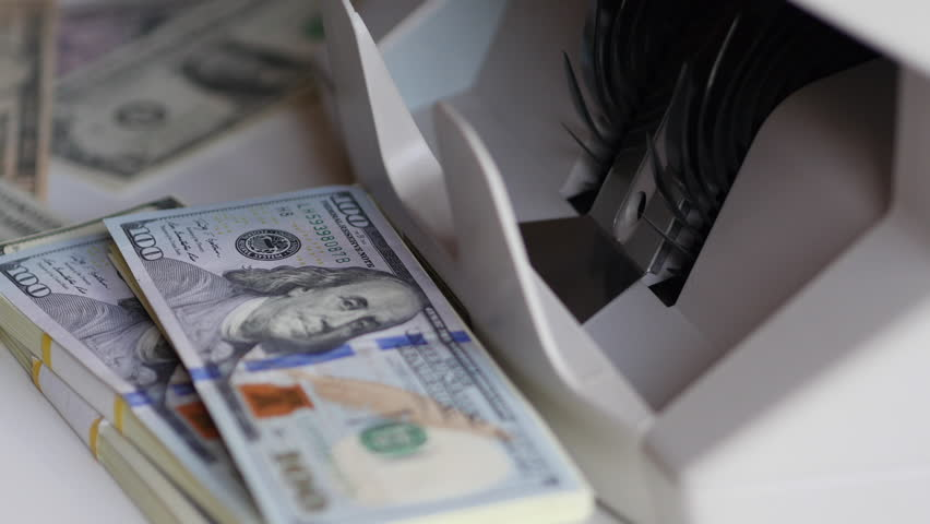 Counting US Dollars Banknotes On Currency Counter Machine | Shutterstock HD Video #31827910