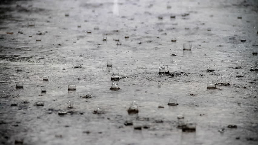 Closeup shot of heavy rain on road/Rain Road