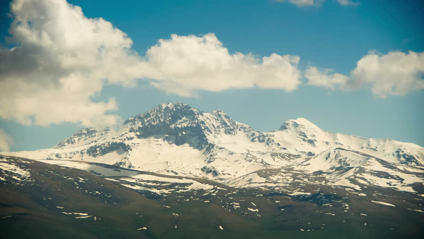 Landscapes and mountains of Armenia. Clouds move over the snowy peaks of the mountains in Armenia. Time Lapse. Summer, Sunny day