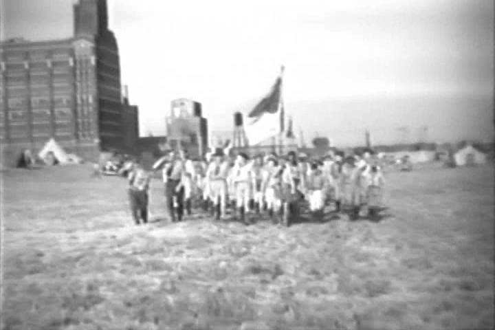 CIRCA 1930s - Boy scouts start a fire, set up tents, cook and sleep, in a camp, in North Kansas City, Missouri, in 1933.