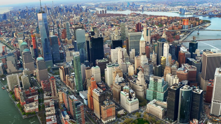 Aerial view of skyscrapers in Lower and Midtown Manhattan. Brooklyn and Manhattan Bridge in the background. Shot from a helicopter. | Shutterstock HD Video #31885075