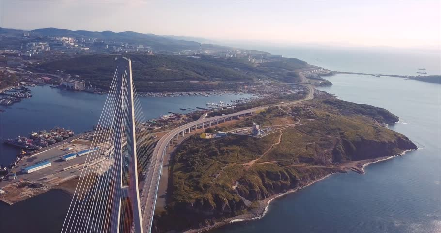 Amazing aerial view of the Russky Bridge, the world's longest cable-stayed bridge, and the Russky (Russian) Island in Peter the Great Gulf in the Sea of Japan. Sunrise. Vladivostok, Russia | Shutterstock HD Video #31892848