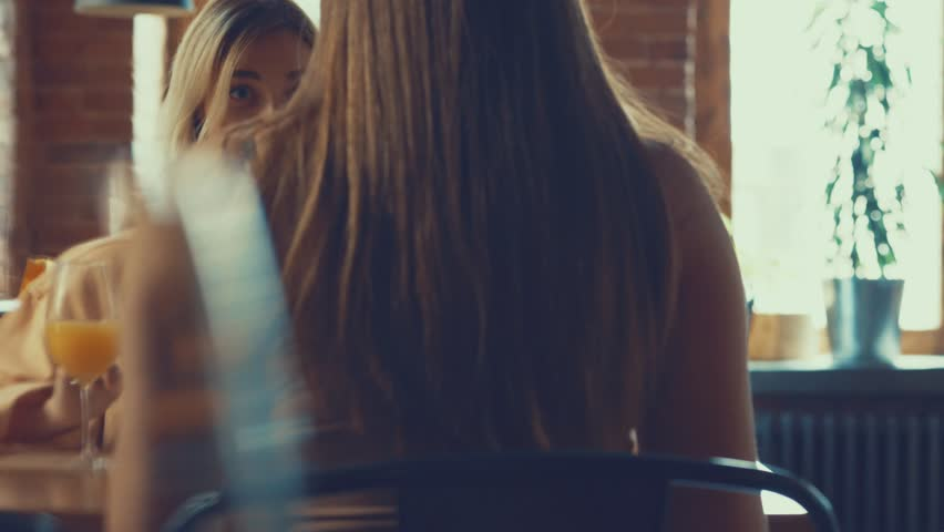 Friends in a restaurant | Shutterstock HD Video #31903405