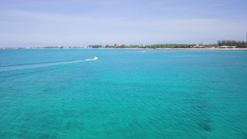 Aerial footage of turquoise waters in the tropical paradise of the cayman islands in the caribbean sea