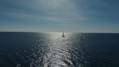 Aero shooting of two yachts in the open sea