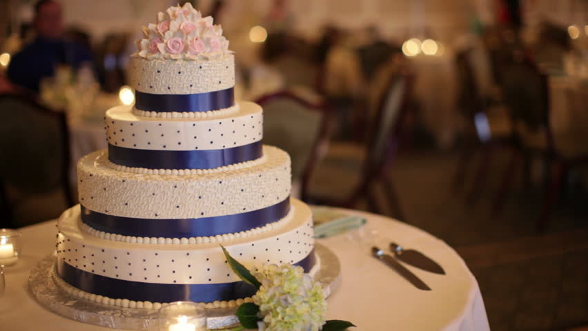 A blue banded wedding cake
