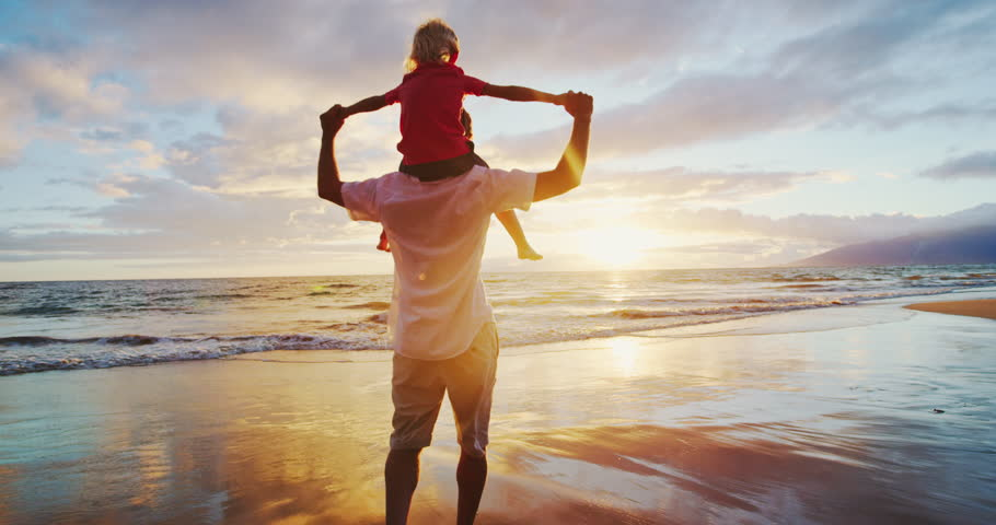 Father and son on the beach at sunset #31935232