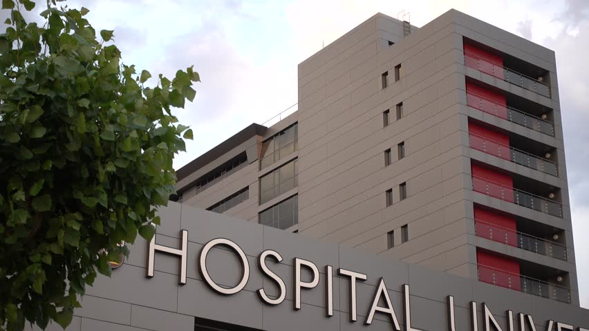 MADRID, SPAIN - OCTOBER 2017. Health Care Hospital Sign And Modern Building Exterior at sunset