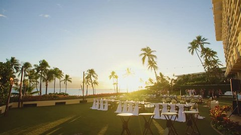 wedding banquet tables outdoors among picturesque nature in sunset on resort hyatt,maui,hawaii