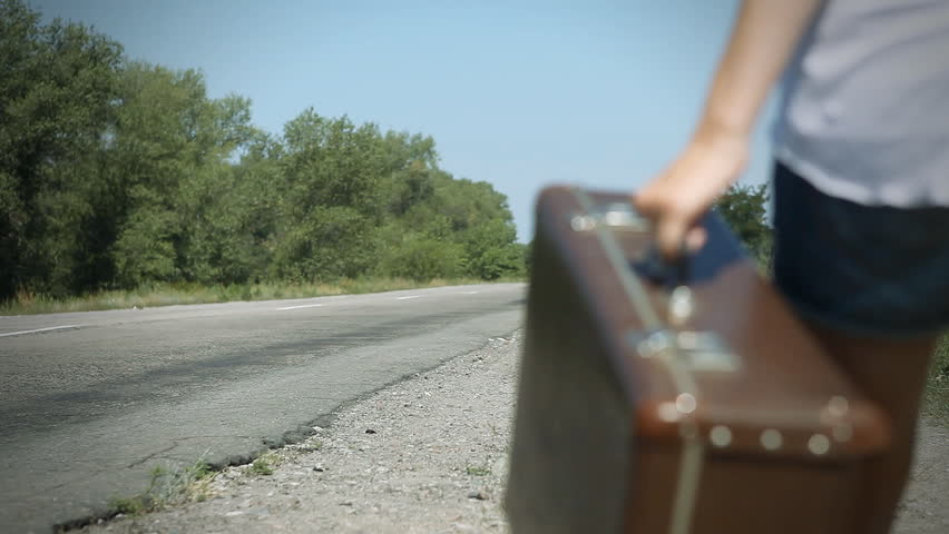Young woman with guitar on the road and her vintage baggage | Shutterstock HD Video #3195556