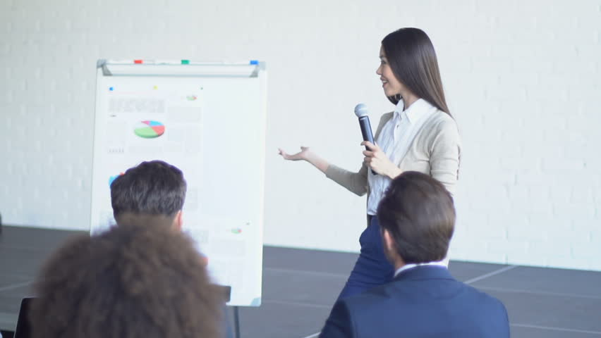 Group Of Business People Asking Question To Businesswoman Leading Presentation Discussing Financial Report Slow Motion | Shutterstock HD Video #31958407