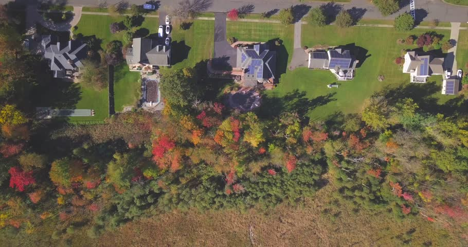 Ariel view of Flying over New England houses in the fall autumn season, Autumn season in New England.