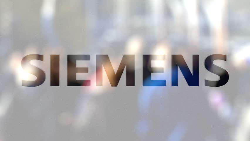 Siemens logo on a glass against blurred crowd on the steet. Editorial 3D rendering | Shutterstock HD Video #31958923