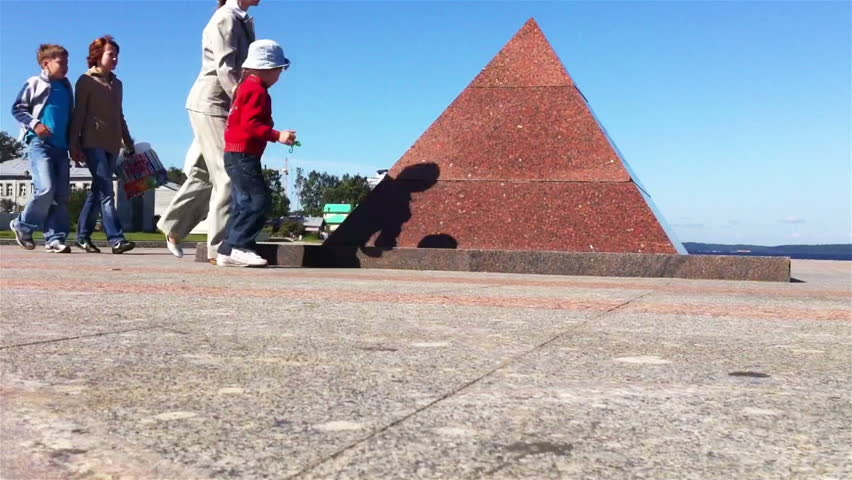PETROZAVODSK, RUSSIA -JULY 25: Time lapse of kids playing on pyramid monument on July 25, 2011, Petrozavodsk, Russia. Pyramid monument built to commemorate new city quay construction