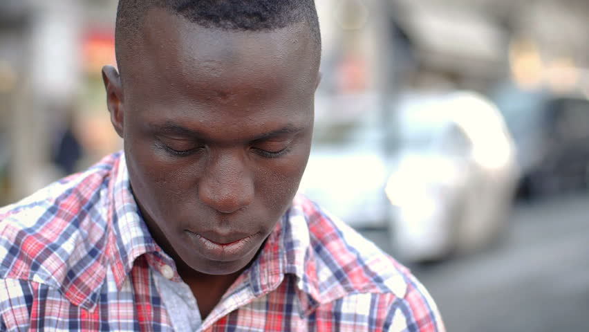 Sad and thoughtful African migrant looks at the camera- slow motion | Shutterstock HD Video #31968238