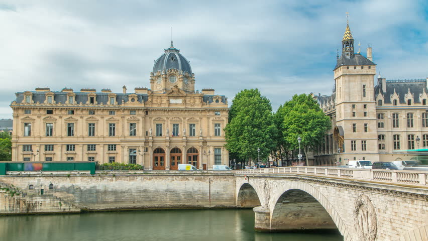 Castle Conciergerie and Commercial Court of Paris timelapse - former royal palace and prison. Bridge to Change. Conciergerie located on the west of the Cite Island. Paris, France.