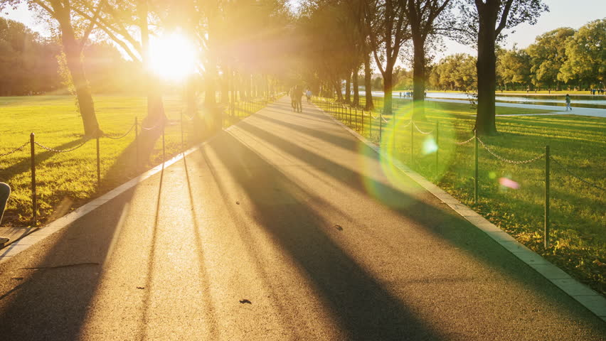 Hyperlapse video: A long avenue for pedestrians at sunset. People go jogging. Washington, DC