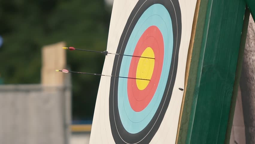 People shooting arrows, bow, archery. Symbol of victory achievement success