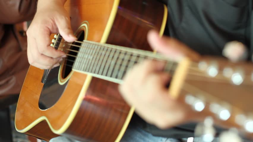 hd video of guitarist playing acoustic guitar/acoustic guitarist/guitarist playing acoustic guitar close up