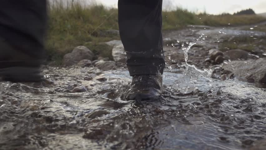 Scotland - hiking boot in water - slow motion (1080p400 conformed to 1080p25)