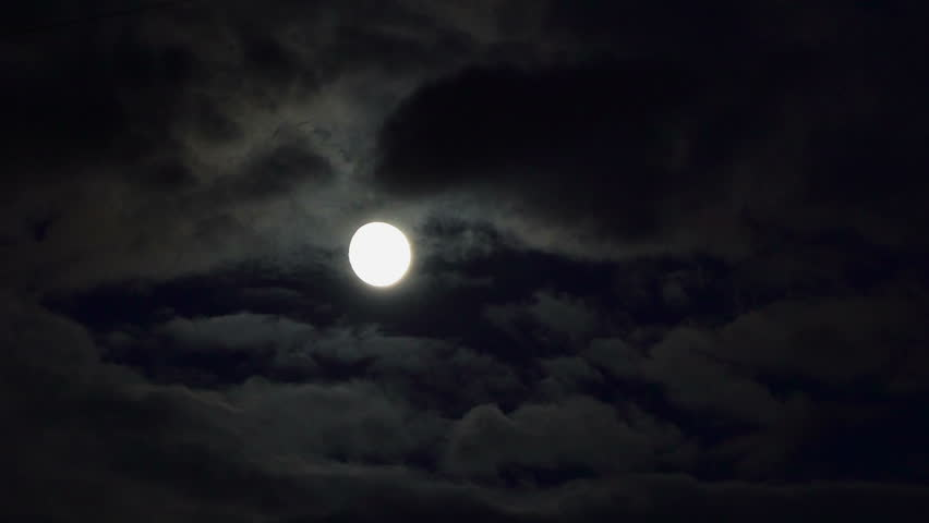 Clouds passing by moon at night. Full moon at night with cloud real time. Details on surface visible   Shutterstock HD Video #31991689