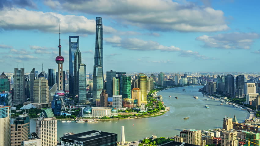 4K: Zoom out timelapse: Shanghai skyline,China.Pudong modern building,Huangpu River,the bund viewed from skyscraper.