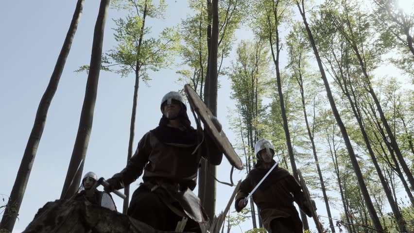 Vikings running in the forest to fight in a battle
