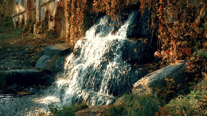 Waterfall on the Ruins in the Autumn Slowmotion | Shutterstock HD Video #32017513