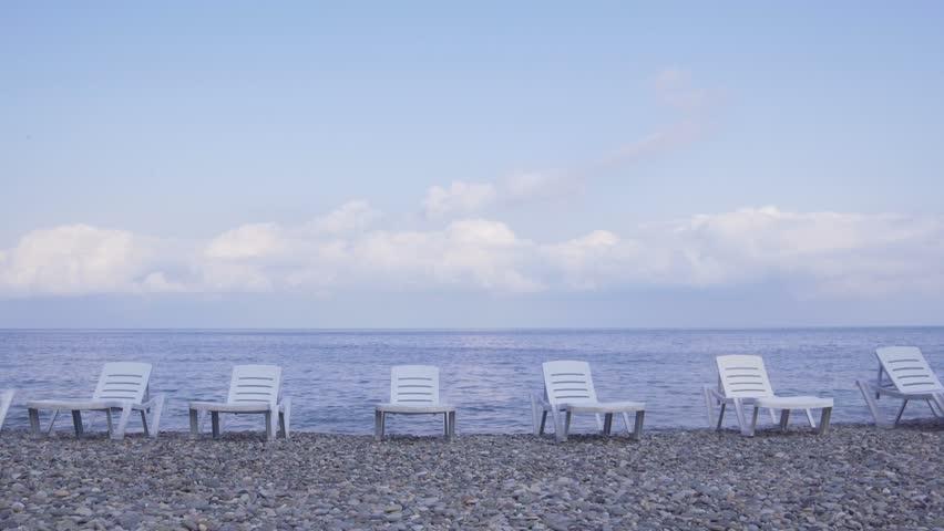 empty beach, only sun loungers