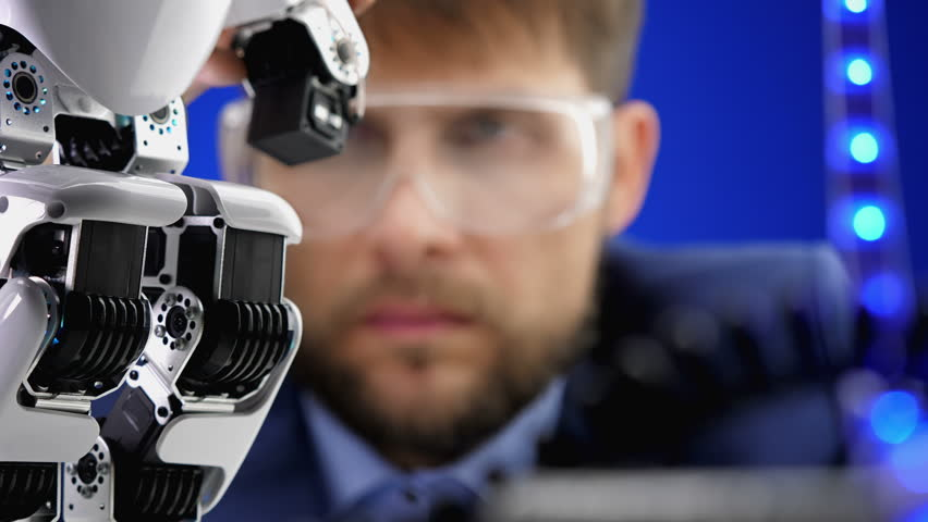 Close up electronics engineer working in lab building and testing robot mechanism. | Shutterstock HD Video #32021128