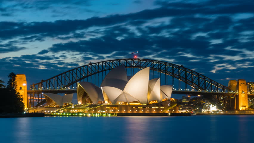 Sydney, Australia - May 13, 2017: 4k timelapse video of Sydney Opera House and Harbour Bridge from sunset to night