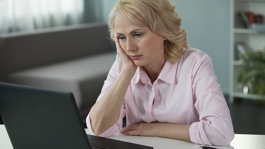 Senior lady sleepy and tired from boring job, needs life changes, lack of energy   Shutterstock HD Video #32029126