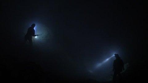 Sulfur miners at Ijen volcano in the night. Kawah Ijen volcano in East Java, Indonesia.
