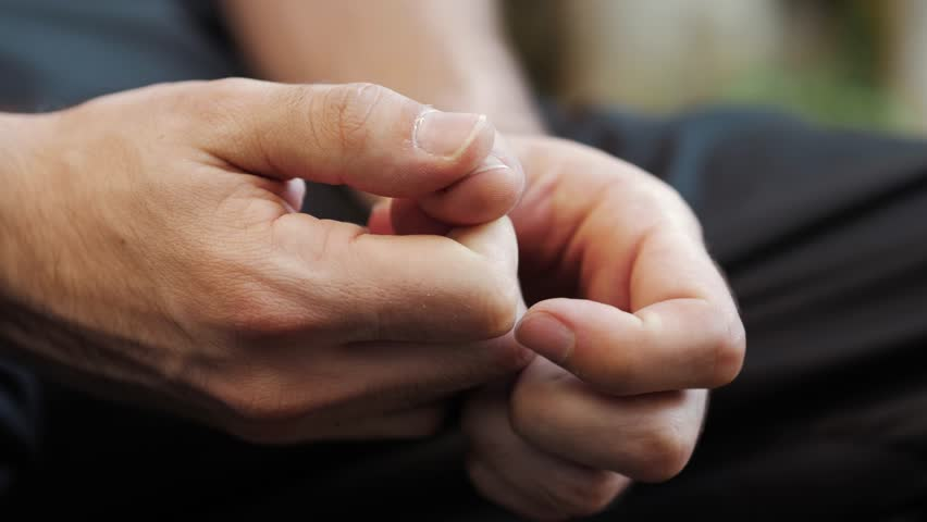 Close up on the hands of the stress young man sitting outside | Shutterstock HD Video #32035411