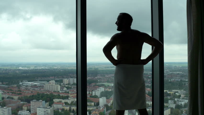 Young man in towel admire view from window  #32038648