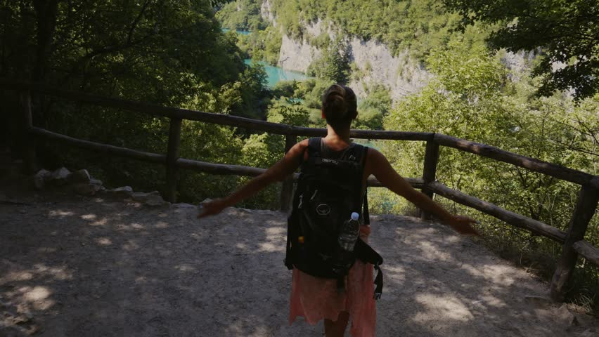 Woman visiting Plitvice Lakes National Park | Shutterstock HD Video #32043610